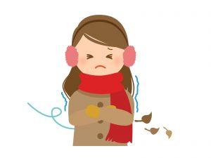寒さに耐える女性の絵